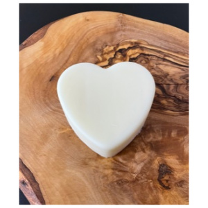 heart shaped lotion bar natural on wood background