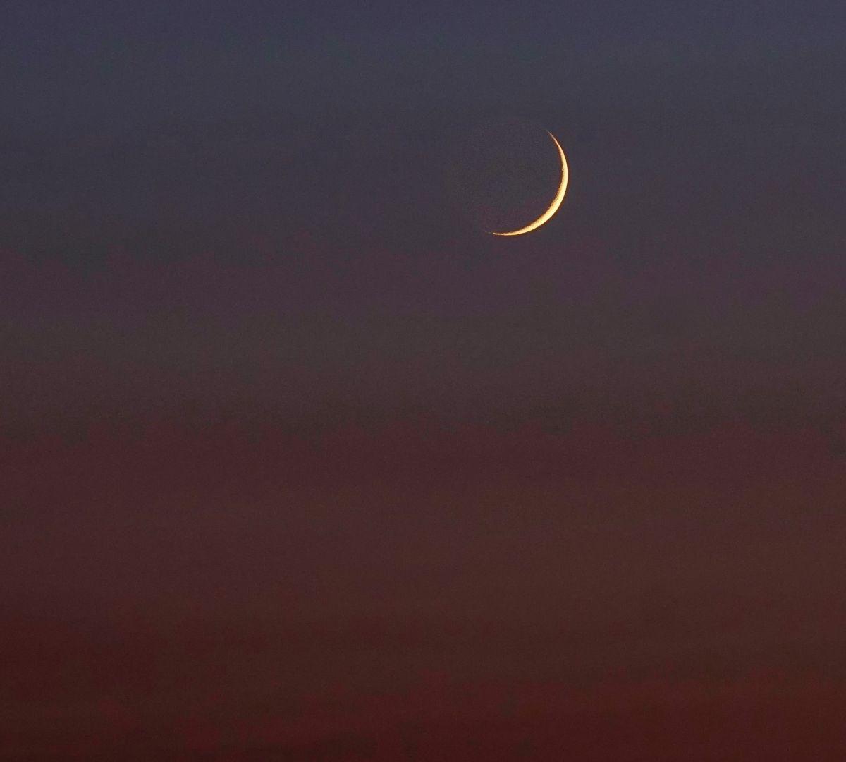 New Moon in a dark sky