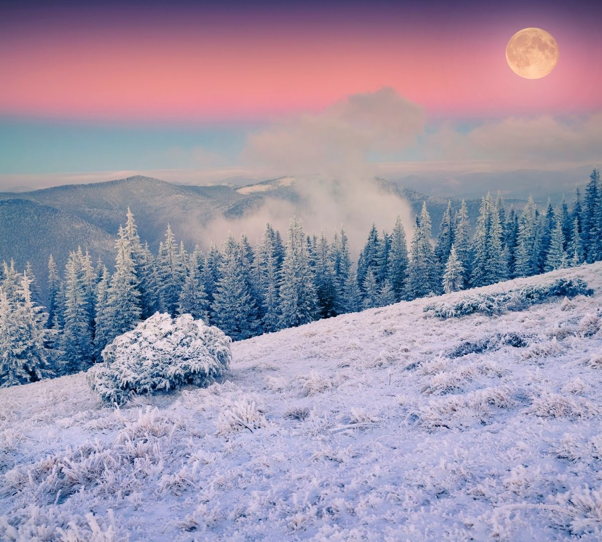 Full Moon with pink and blue sky and a frosty mountain scene